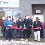 Dustin Cutting the Ribbon at the Grand Opening