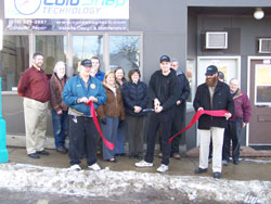 Dustin Miller cuts the ribbon held by Ben Marolt & Edward Addy at the Grand Opening Ceremony of Cold Snap Technology's Eveleth Office location.